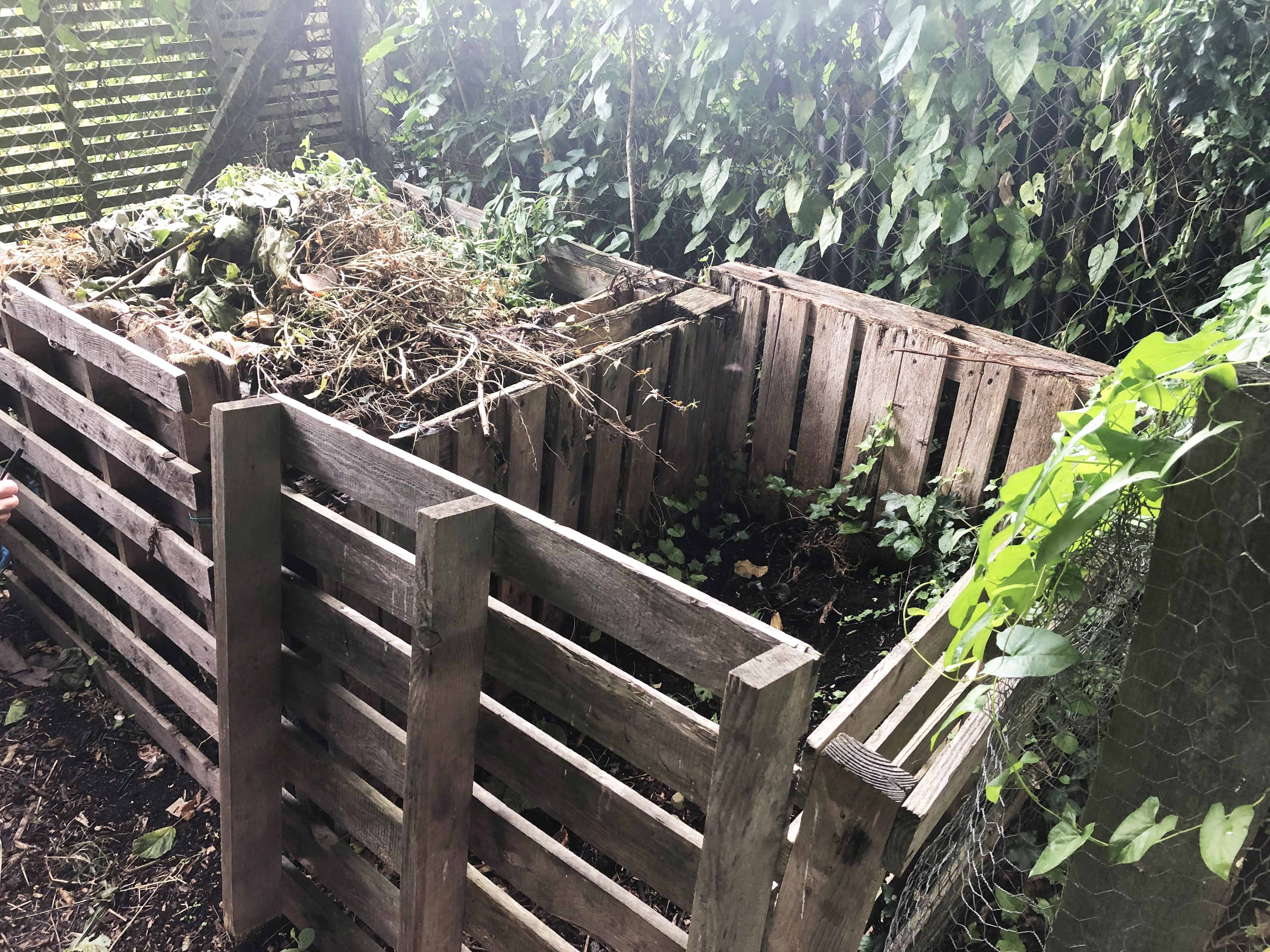 image of slatted wooden composters