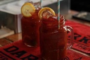 image of tomato juice in mason jar with lemon